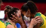(L-R) Brazil's Macris Silva Carneiro and Ana Menezes Oliveira de Souza celebrate their victory in the women's quarter-final volleyball match between Brazil and Russia during the Tokyo 2020 Olympic Games at Ariake Arena in Tokyo on August 4, 2021. PEDRO PARDO / AFP