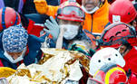 Elif Perincek, a three-year-old survivor, holds the thumb of a rescue worker as she is carried out of a collapsed building after an earthquake in the Aegean port city of Izmir, Turkey November 2, 2020. Serkan Oktar/Istanbul Fire Department/Handout via REUTERS ATTENTION EDITORS - THIS IMAGE HAS BEEN SUPPLIED BY A THIRD PARTY. THIS PICTURE WAS PROCESSED BY REUTERS TO ENHANCE QUALITY. AN UNPROCESSED VERSION HAS BEEN PROVIDED SEPARATELY. MANDATORY CREDIT. NO RESALES. NO ARCHIVES