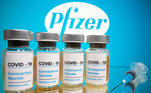Vials with a sticker reading, 'COVID-19 / Coronavirus vaccine / Injection only' and a medical syringe are seen in front of a displayed Pfizer logo in this illustration taken October 31, 2020. REUTERS/Dado Ruvic/Illustration
