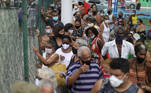 People line up for having their first dose of Sinovac's CoronaVac coronavirus disease (COVID-19) vaccine for senior citizens in Duque de Caxias, Rio de Janeiro state, Brazil March 5, 2021. REUTERS/Pilar Olivares