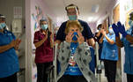 Margaret Keenan, 90, is applauded by staff as she returns to her ward after becoming the first person in Britain to receive the Pfizer/BioNTech COVID-19 vaccine at University Hospital, at the start of the largest ever immunisation programme in the British history, in Coventry, Britain December 8, 2020. Britain is the first country in the world to start vaccinating people with the Pfizer/BioNTech jab. Jacob King/Pool via REUTERS TPX IMAGES OF THE DAY
