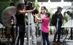A family use a hand sanitizer station as the National Zoo reopens for socially-distanced patrons for the first time since the start of the coronavirus disease (COVID-19) outbreak in Washington, U.S. July 24, 2020. REUTERS/Jonathan Ernst