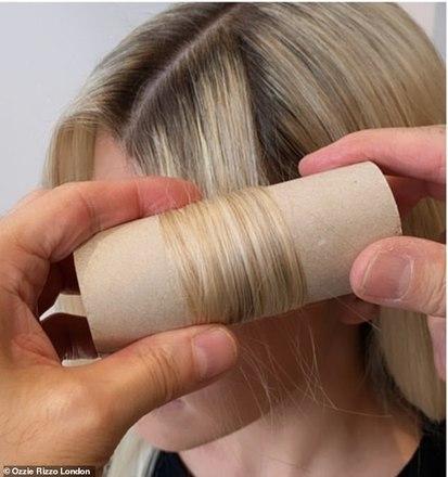Em seguida, pegue cerca de 10 rolos de loo vazios e, começando pelas pontas, enrole o cabelo ao redor do rolo e continue para cima, antes de prender cada seção com um grampo