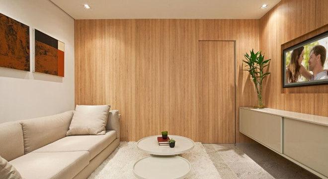 Sala de estar com mesa redonda de centro branca Projeto de Eduarda Correa