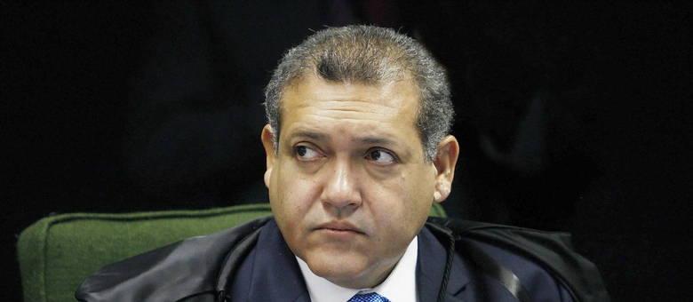 """Kassio Nunes, o ministro do STF que Bolsonaro diz estar """"fechado"""" com ele."""