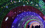CHINA-LIFESTYLE This photo taken on February 24, 2021 shows people walking across an arcade decorated with lights at the citizen square in Zhangjiakou, in northern Hebei province. STR / AFP