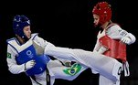 Brazil's Milena Titoneli (Blue) and Croatia's Matea Jelic (Red) compete in the taekwondo women's -67kg quarter-final bout during the Tokyo 2020 Olympic Games at the Makuhari Messe Hall in Tokyo on July 26, 2021.