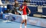 Novak Djokovic of Serbia walks off after losing his semifinal match against Alexander Zverev of Germany
