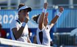 . Laura Pigossi of Brazil and Luisa Stefani of Brazil celebrate after winning their quarterfinal match against Bethanie Mattek-Sands