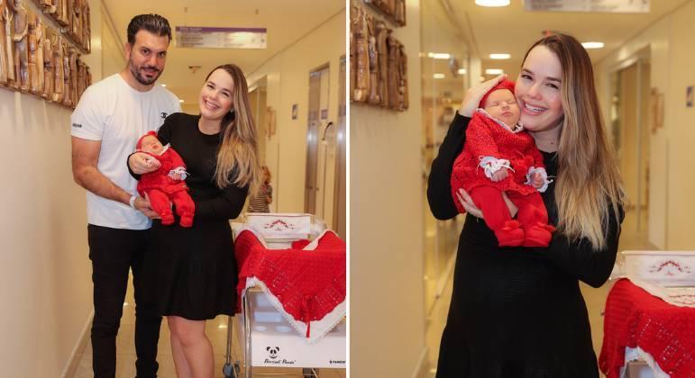 Thaeme deixa a maternidade com a filha Ivy e o marido Fábio Elias