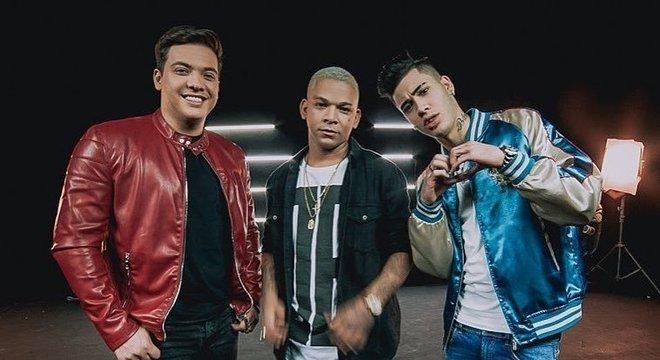 Wesley Safadão, Aldair Playboy e Kevinho durante gravação de clipe