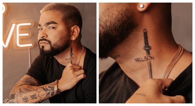 Yudi tatuou nome do pai no pescoço